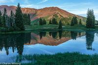 Sun, pond, mountains, reflection