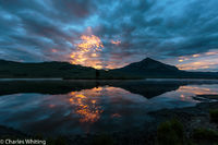 Sun, lake, mountains, clouds, reflections