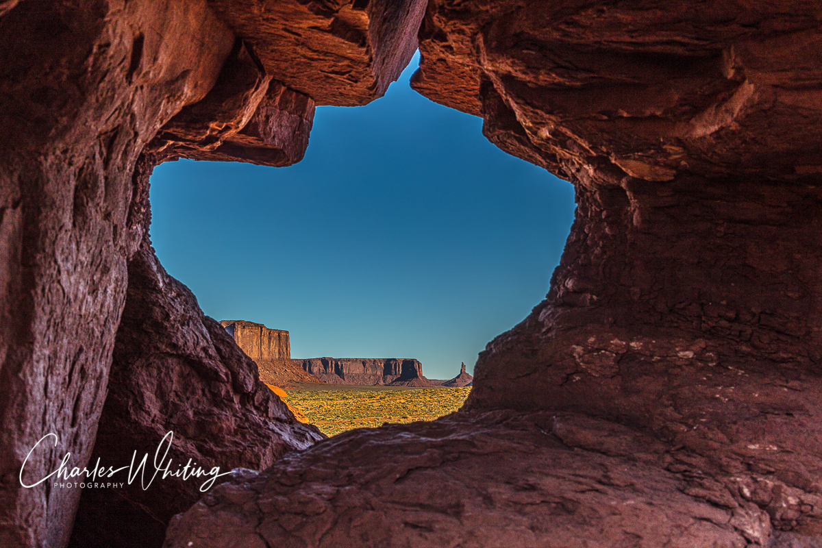 Buttes at Sunset Framed by a Rock Window, Monument Valley, Arizona